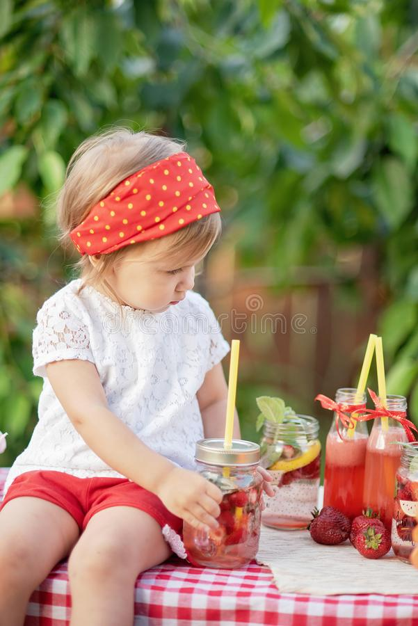 Strawberry and mint infused detox water. strawberry lemonade with ice and mint as summer refreshing drink in jars. Cold soft. Lemonade Stand. Adorable little royalty free stock photos