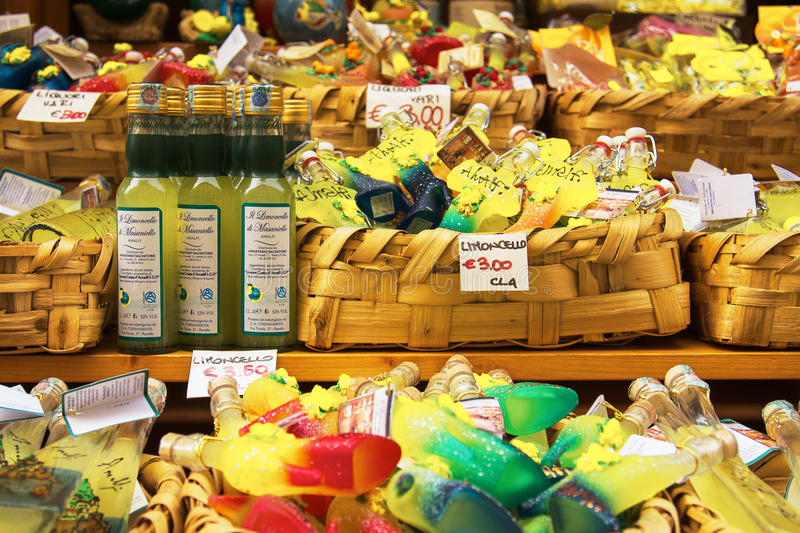 Lemoncello in Various Shapes Sold in Market in Amalfi Italy stock images