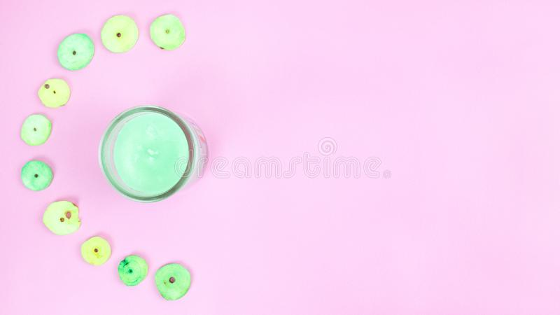 Lemongrass Scented Candle And Buttons Pink Backdrop stock photo