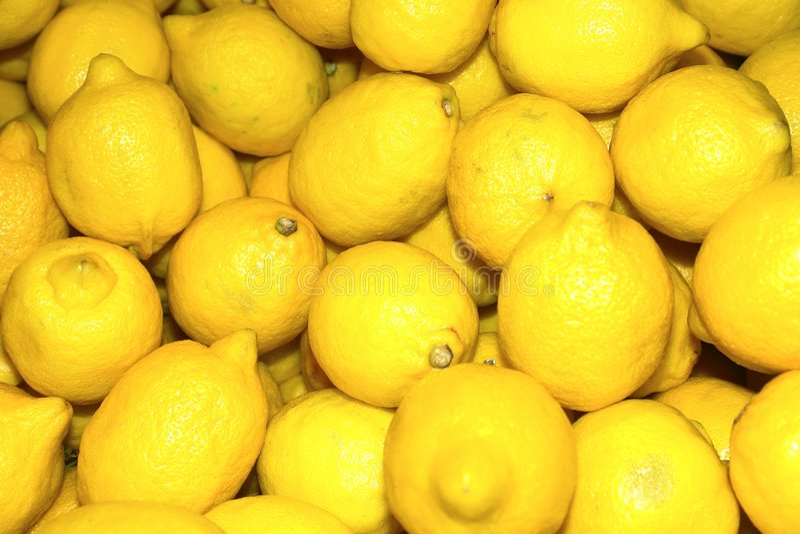 Lemons. Colourful display of bright yellow lemons