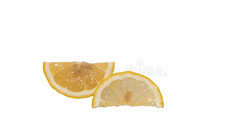 Lemons are cut into thin pieces. royalty free stock image