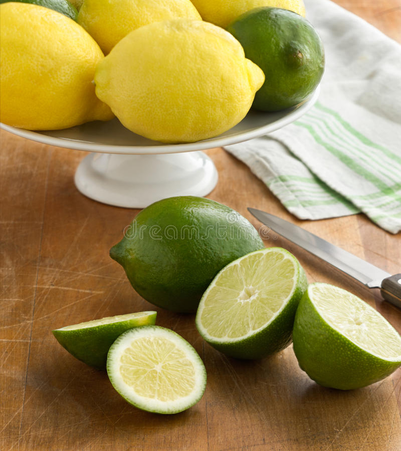 Lemons and Limes. Fresh lemons and limes in the kitchen stock images