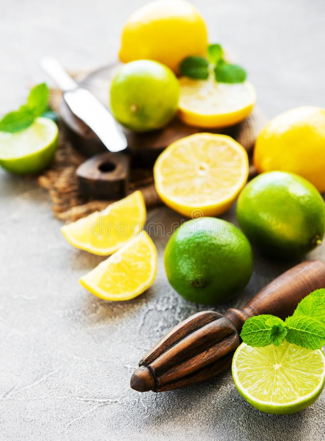 Lemons and limes. On a concrete background royalty free stock photos