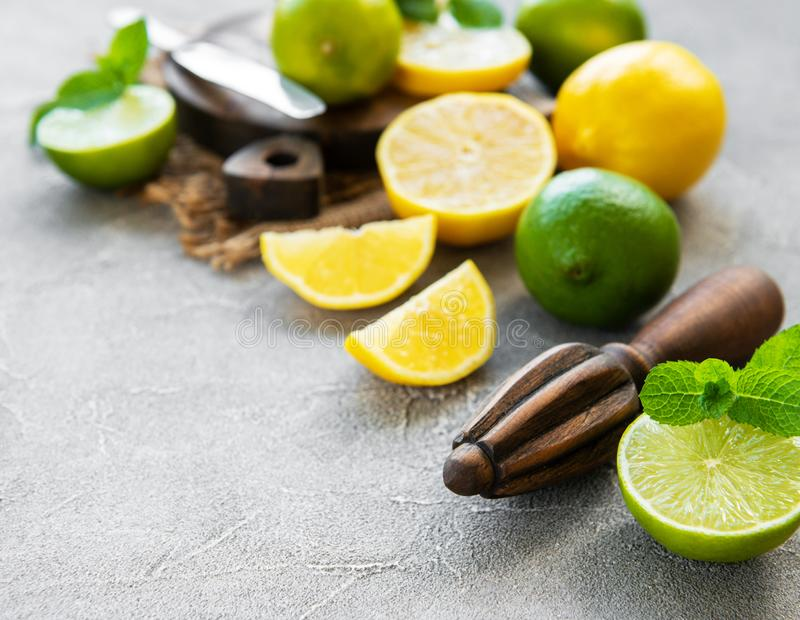 Lemons and limes. On a concrete background royalty free stock photography