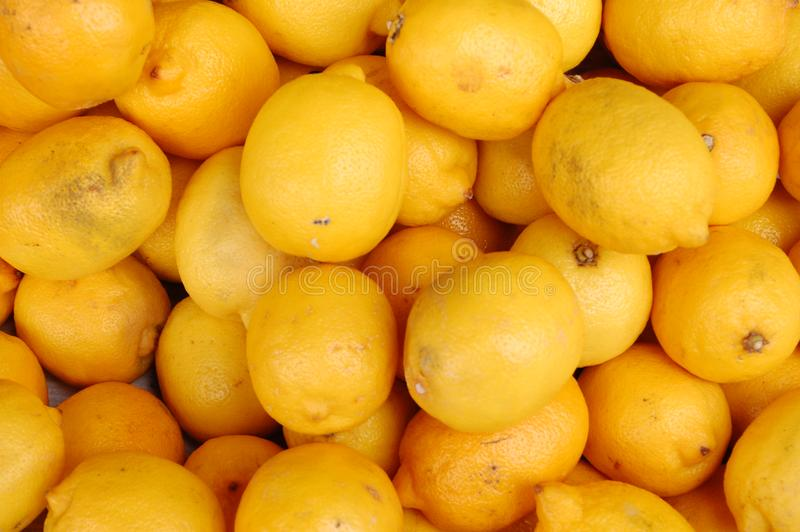 Lemons on the market royalty free stock photography
