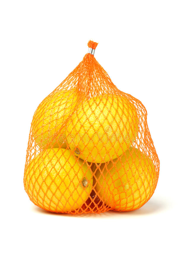 Lemons in plastic netting stock image