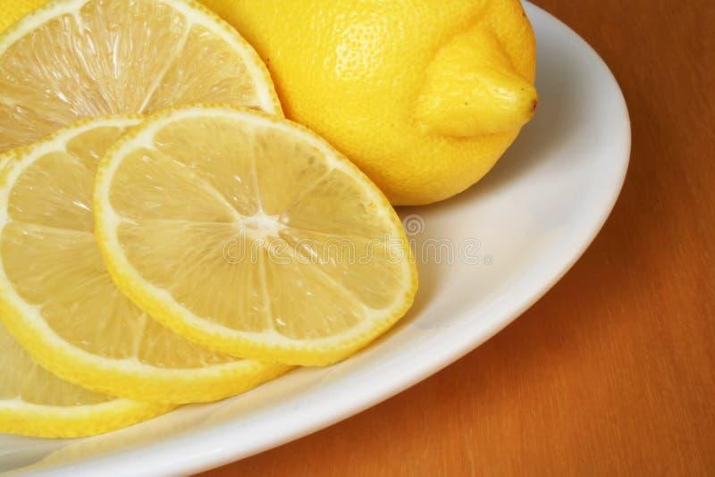 Lemons on the plate. Fresh lemons on the plate royalty free stock image