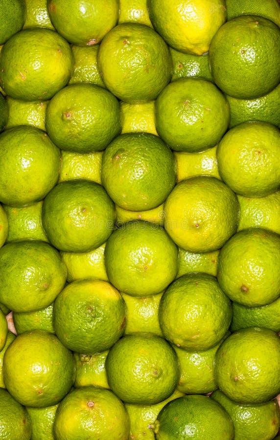 Lemons regular ordered pile background. Macro. Lemons on a regular background. Yellow and green. Photo taken with macro lens royalty free stock photo