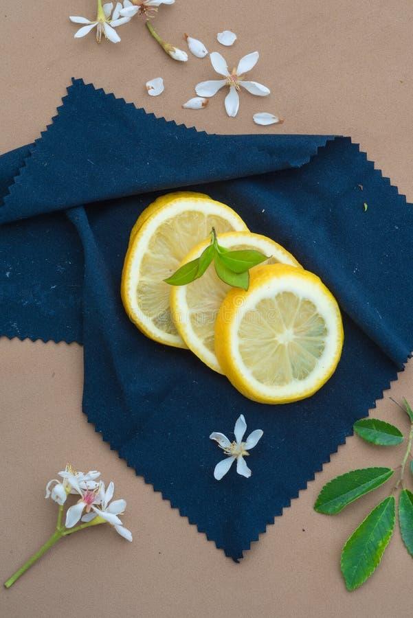 Lemons slices on a blue cloth royalty free stock photos