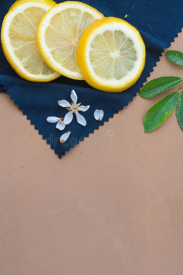 Lemons slices on a blue cloth royalty free stock images