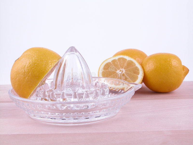 Lemons squeezer royalty free stock images