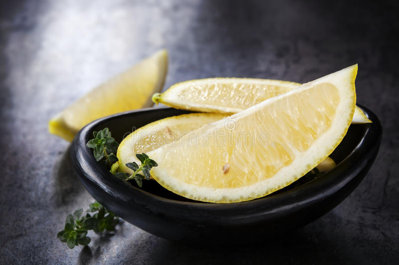 Download Lemons and Thyme stock photo. Image of black, lemons - 41198040