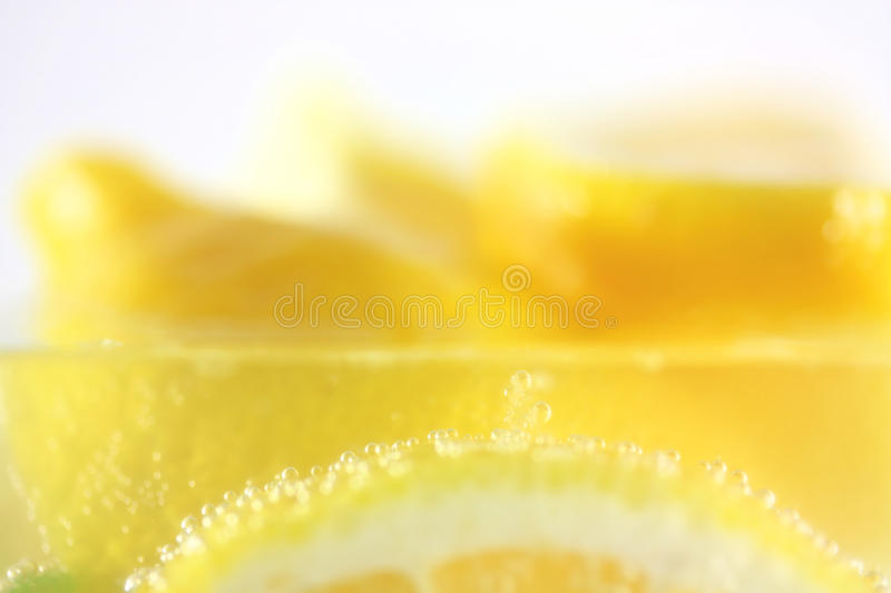 Lemons In Water With Bubbles Stock Photo