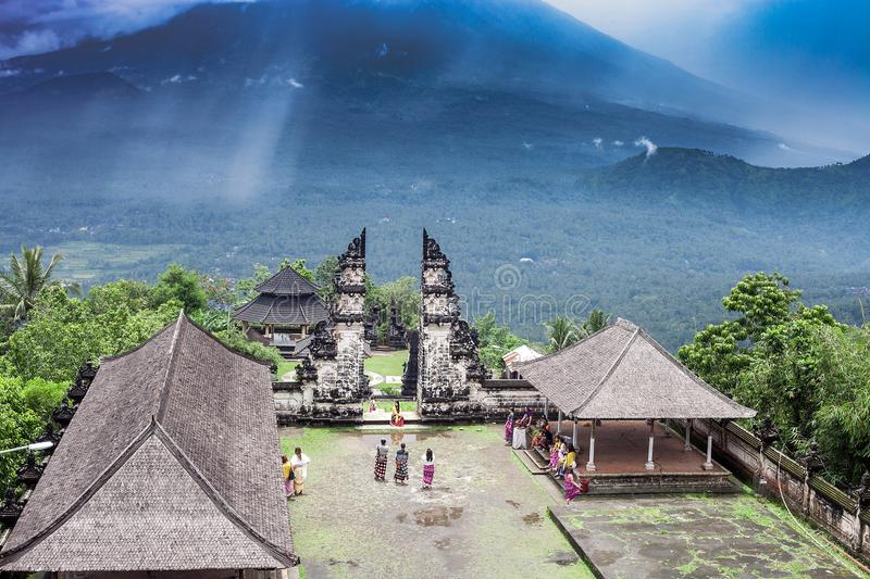 Lempuyang temple and Agung mount in stormy dark clouds, Bali stock images