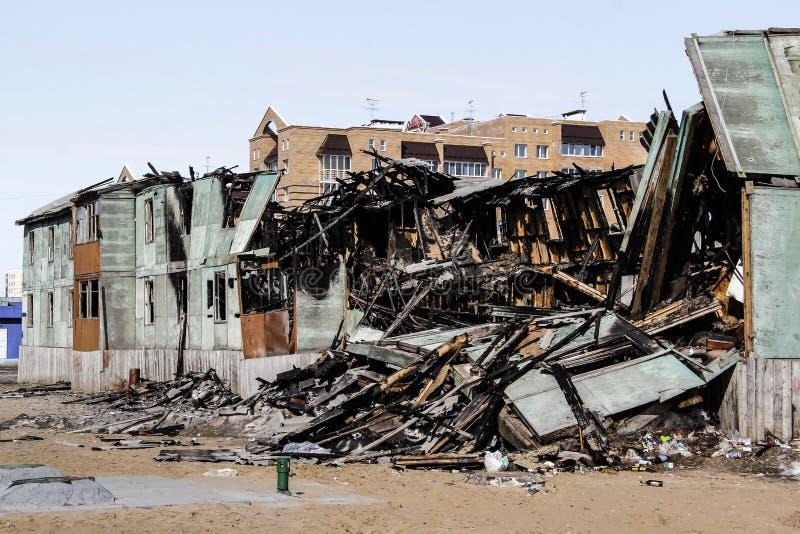 Lendemain d'un feu dans la maison photographie stock libre de droits