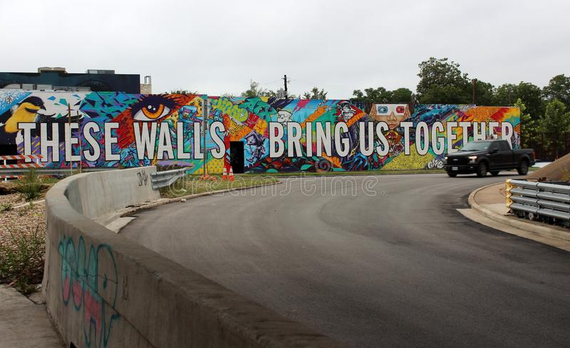 Long brick wall with bright colorful words filled with hope, Austin Texas, 2018 stock photo