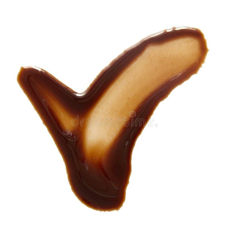 Lenguados y descensos del chocolate derretido aislado en blanco fotos de archivo libres de regalías