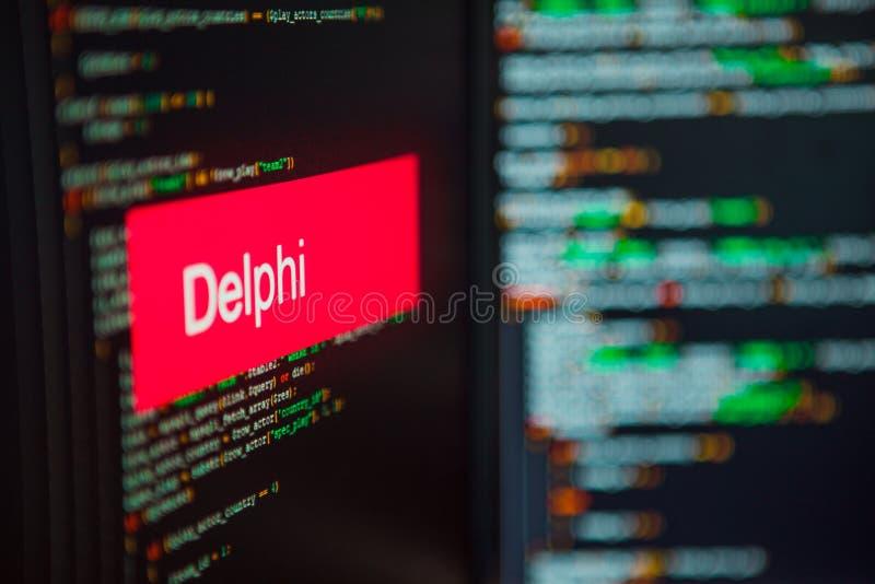 Lenguaje de programación, inscripción de Delphi en el fondo del código de ordenador fotografía de archivo