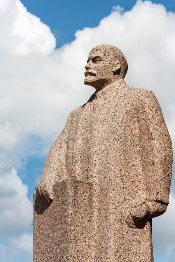 Lenin granite monument. Vladimir Lenin granite monument on sky background royalty free stock photos