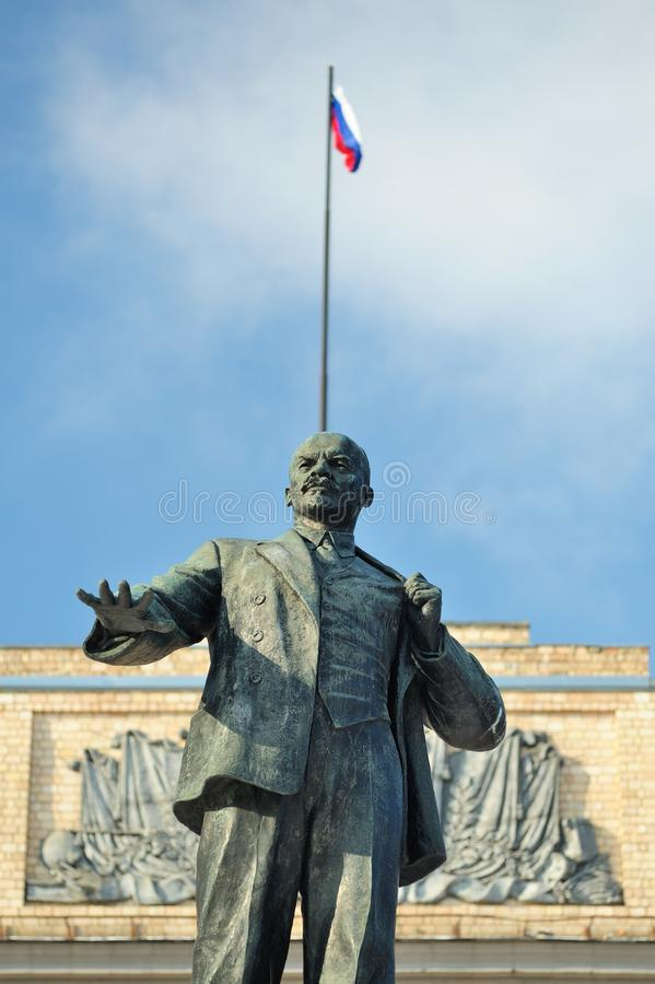 Lenin monument and Russian flag, Orel, Russia. Vertical royalty free stock photography