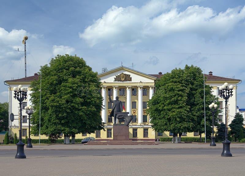 Lenin Monument and Soviet building in Borisov, Belarus. Lenin Monument and Building of the Civil Defense Headquarters on the Central Square of Borisov, Belarus stock image