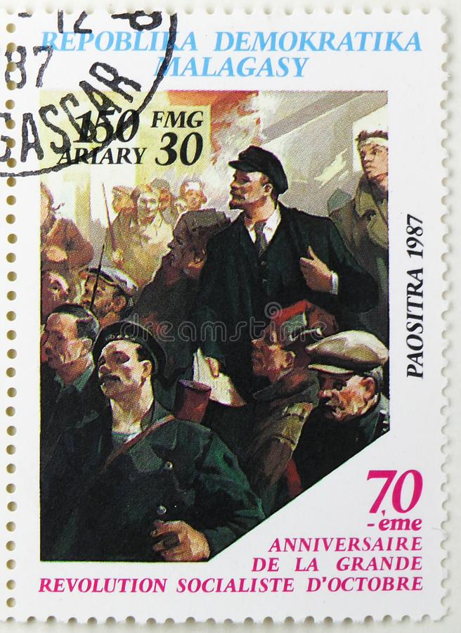 Lenin and sailors, 70th Anniversary of October Revolution serie, circa 1988. MOSCOW, RUSSIA - JULY 25, 2019: Postage stamp printed in Madagascar shows Lenin and stock photography