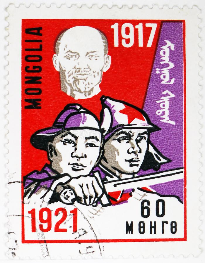 Lenin and soldiers, 50th Anniversary of the October Revolution serie, circa 1967. MOSCOW, RUSSIA - AUGUST 4, 2019: Postage stamp printed in Mongolia shows Lenin stock image