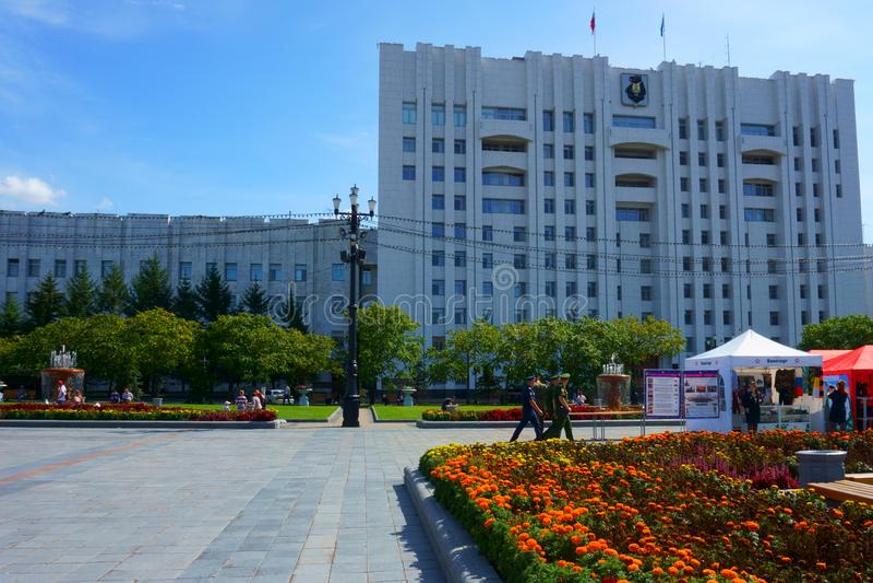 Lenin Square. Khabarovsk Krai Government building. Sale of Army Souvenirs. Khabarovsk / Russia - September 02 2018: Lenin Square. Khabarovsk Krai Government royalty free stock photo