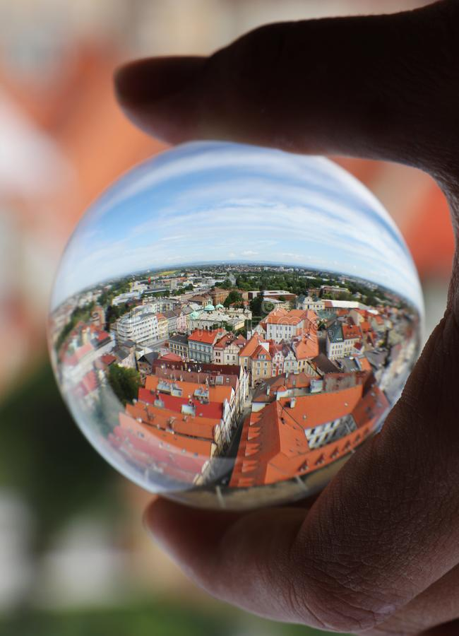Lens ball with reflection of Hradec Kralove city at morning light from white tower. Sky with white clouds. Historical city in. Czech republic stock photos
