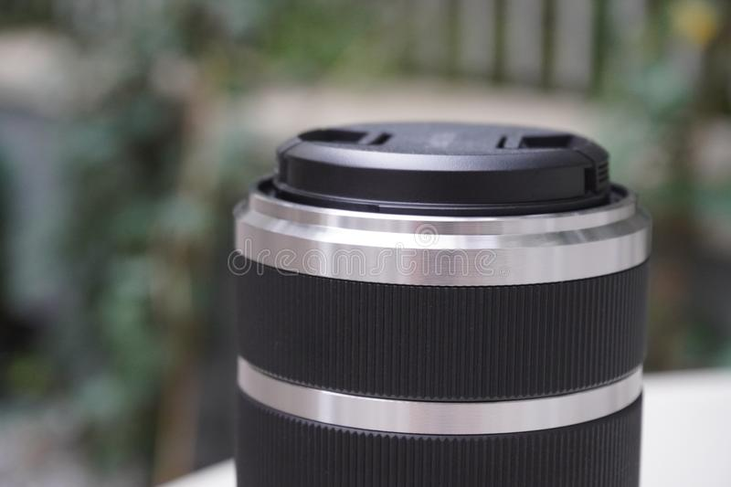 The lens for the camera. on the background of green plants. interchangeable optics for technology. The lens for the camera. on background of green plants royalty free stock photos