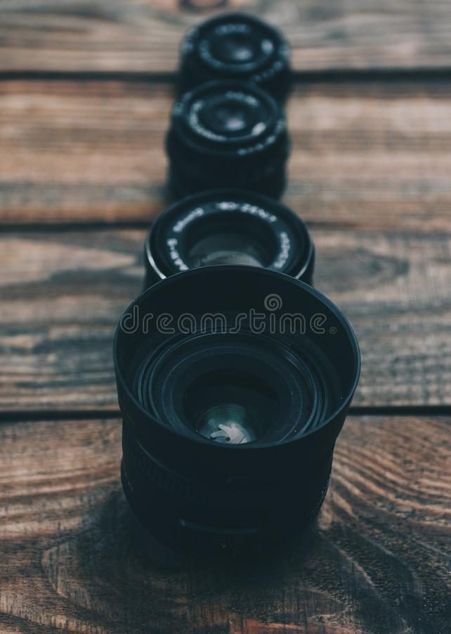 Lens For Dslr Cameras. Lens on the wooden table for dslr camera stock photography