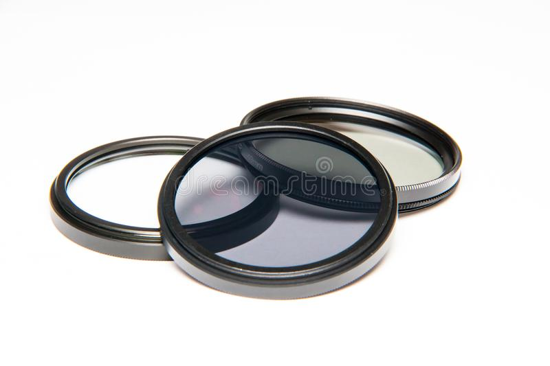 Lens Filters on white background. UV filter, CPL filter, ND filter. Canon and Nikon camera filter stock photos