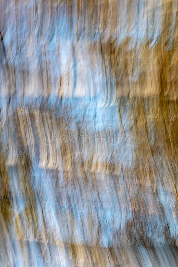 Lens motion blur natural in nature background. Autumn colors abstract royalty free stock image