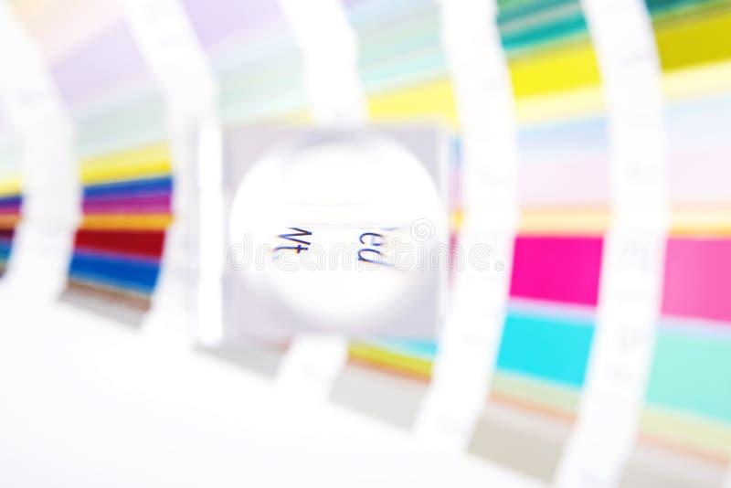 Lens. Prepress blur concept. Lens and pantone. Design and prepress blur concept royalty free stock photo