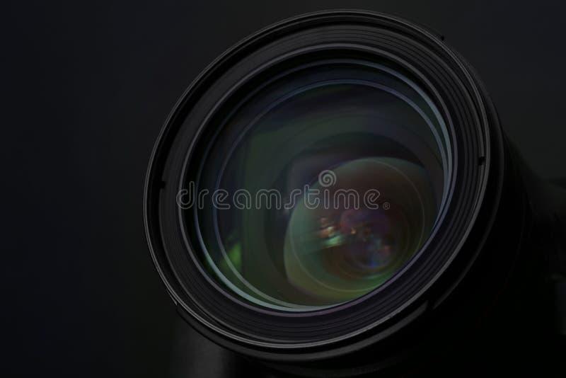 Lens of professional camera on black background. Closeup stock photos