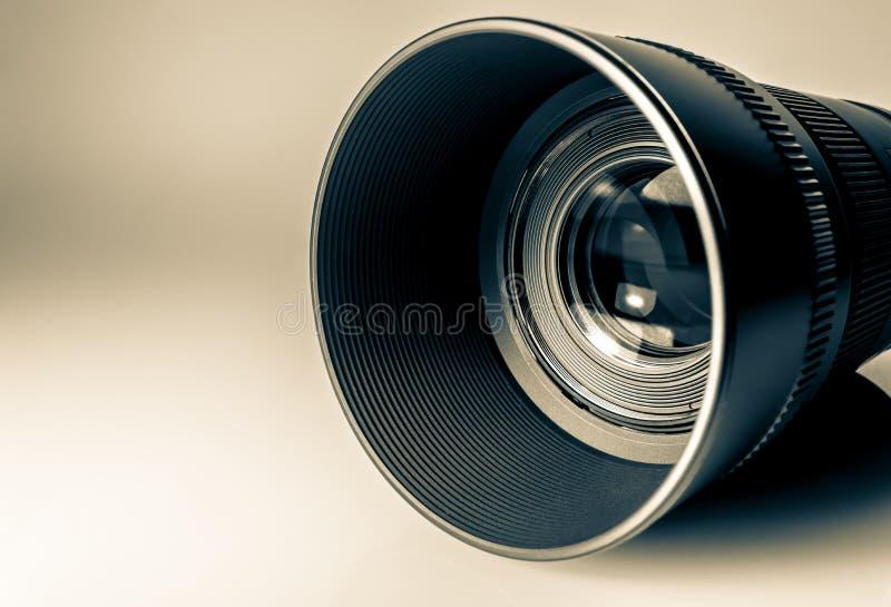 Lens of a SLR camera close-up macro. Old retro style photo. Lens of a SLR camera close-up macro. Old retro style vintage photo royalty free stock photo