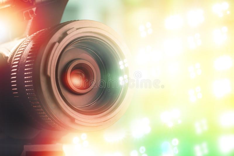 Lens of TV camera in stadium with light background stock image