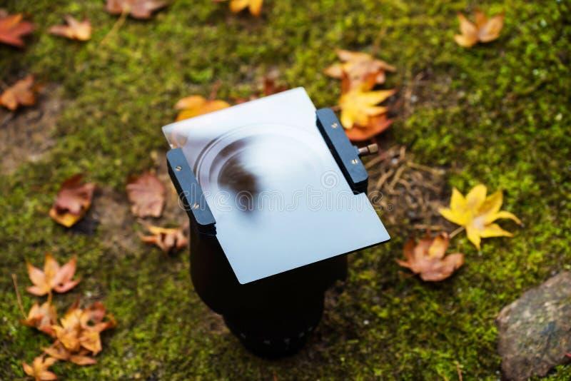 Lense avec la densité neutre graduée et le x28 ; GND& x29 ; photographie stock