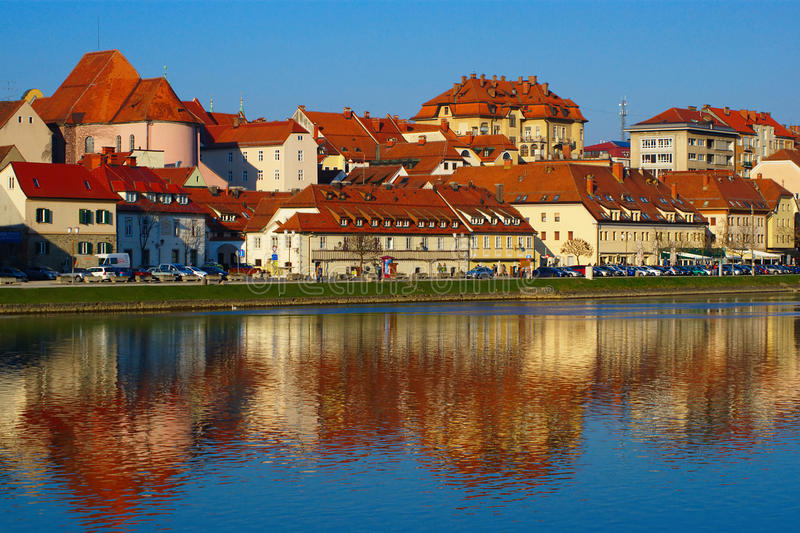 Lent, Maribor, Slovenia. Historic quarter Lent in Maribor, Slovenia, with oldest vine in the world reflecting in Drava river in late spring afternoon royalty free stock photos