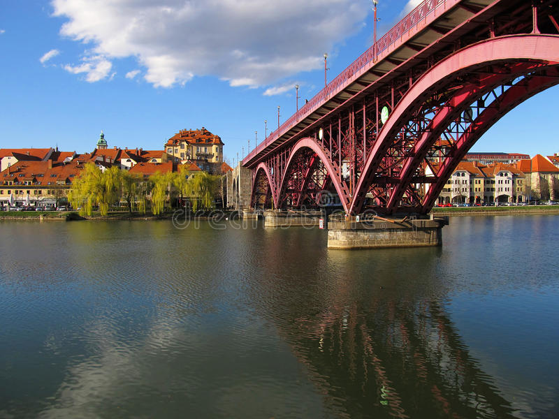 Lent And Old Bridge, Maribor, Slovenia. Historic quarter of Lent and Old Bridge across Drava River in Maribor in Slovenia on sunny spring day stock images