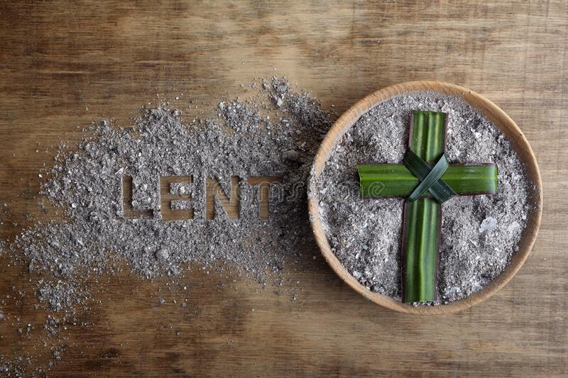 Lent word written in ash, dust as fast and abstinence period concept. Top view. Lent word written in ash, dust as fast and abstinence period concept royalty free stock images