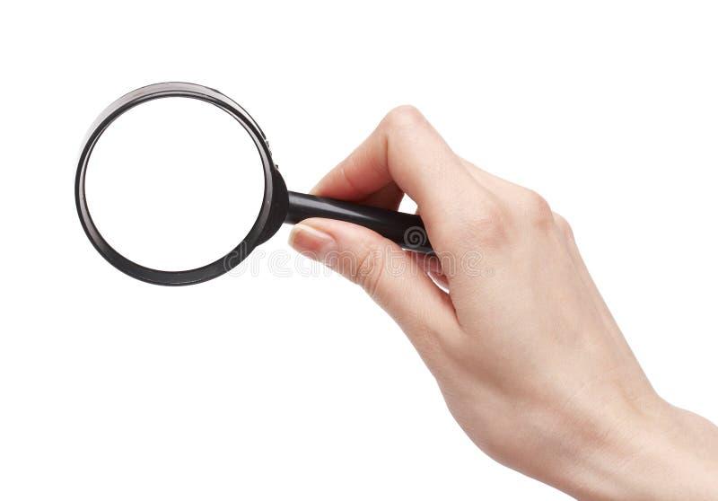 Lente d'ingrandimento della holding della mano immagini stock libere da diritti