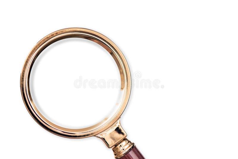 Lente de aumento do ouro no backgroundб branco imagem de stock royalty free