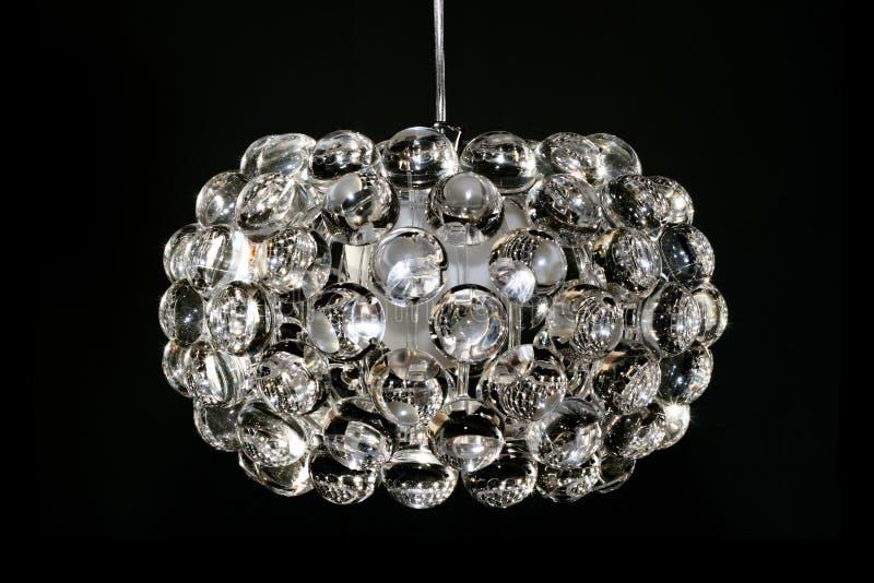 Lente di ingrandimento del lampadario a bracci immagini stock