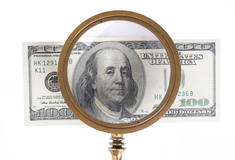Lente do dólar e de ampliação imagens de stock royalty free