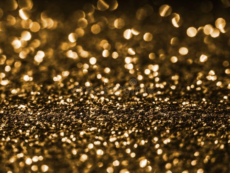 Lentejuela del fondo Chispa de oro del brillo tensioactivador del brillo Fondo del brillo del extracto del día de fiesta con las  foto de archivo libre de regalías
