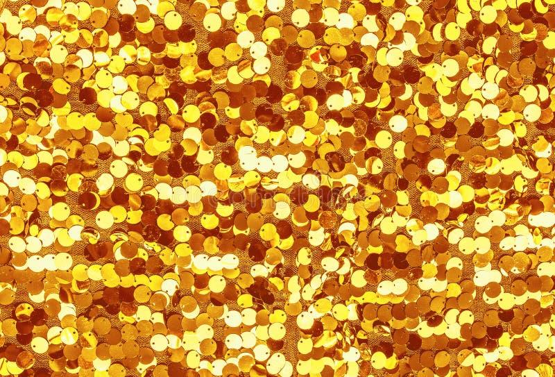Lentejuelas de oro Oro que brilla imágenes de archivo libres de regalías
