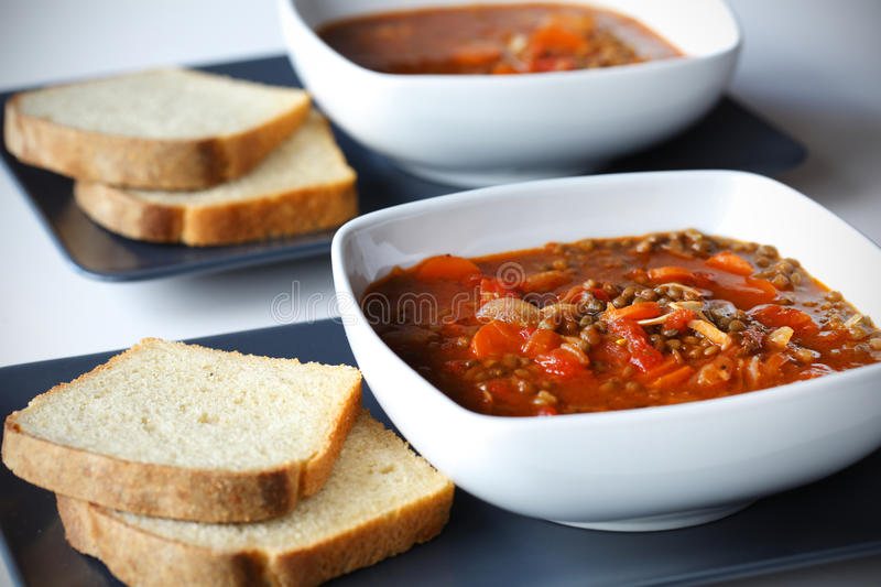 Lentil and other legume stew with carrots stock image