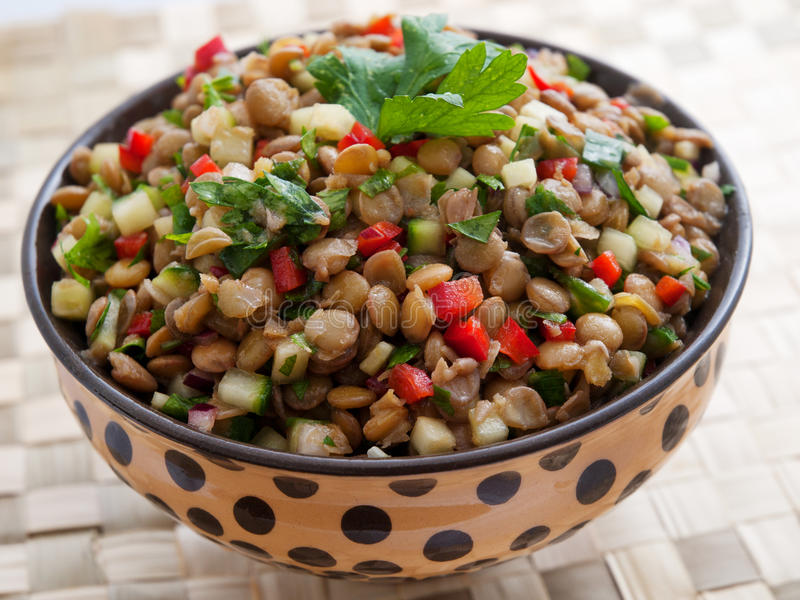 Lentil salad. With cucumbers and red peppers stock photography