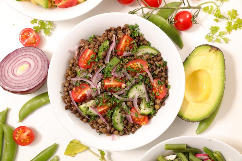 Lentil salad. With tomato and onion royalty free stock photo